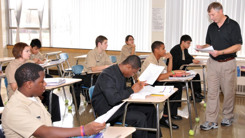 101110-N-0437M-397 MOOSEHEART, Ill. (Nov. 10, 2010) Mooseheart High School science teacher Curt Schlinkman hands out homework to his students who are also Navy Junior ROTC cadets. Mooseheart High School has the only Navy Junior ROTC unit where the cadets live on campus. (U.S. Navy photo by Mike Miller/Released)